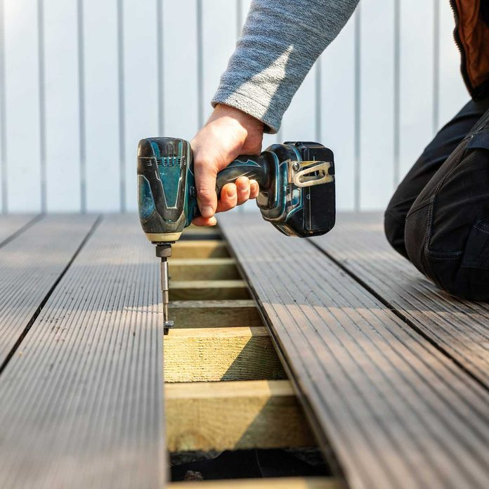Install Compsite Deck Boards Gettyimages 1221950510