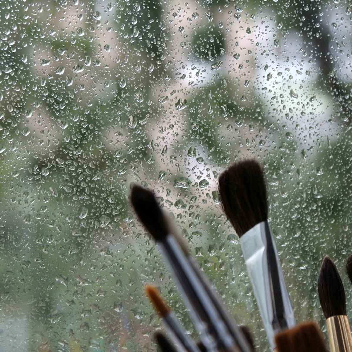 Paint brushes in a Rainy window Gettyimages 511103570