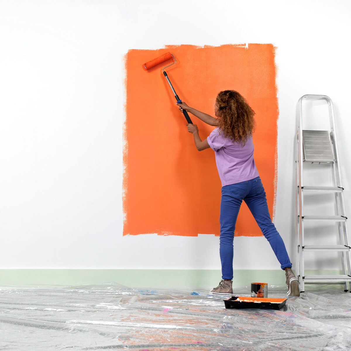 Woman Painting A Wall Gettyimages 174183087