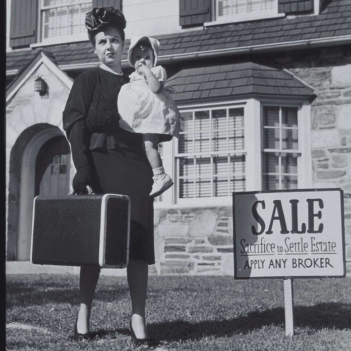Woman With Baby Next To Sale Sign, Circa 1950