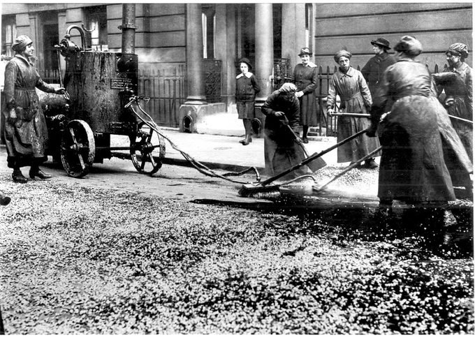 World War I - 1914 - 1918. After conscription in 1916, British women took over many civilian jobs. Women resurfacing a city street in Westminster, London.