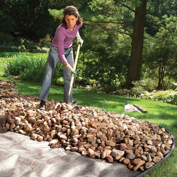 Shoveling stone mulch