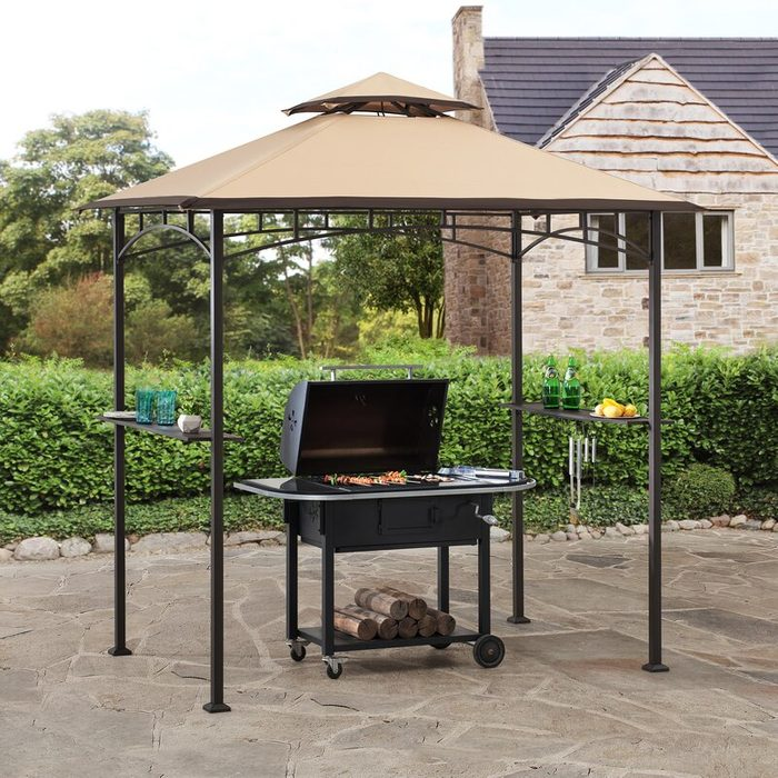 Gazebo covering grill on an outdoor patio