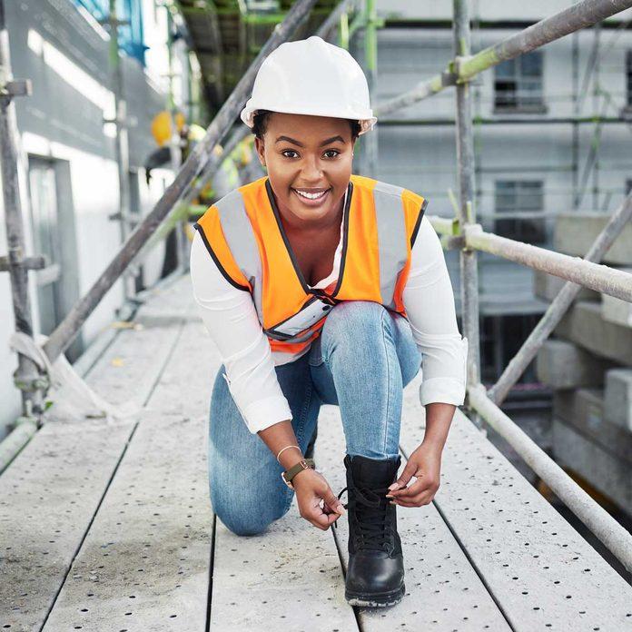 Woman Tying Work Boot