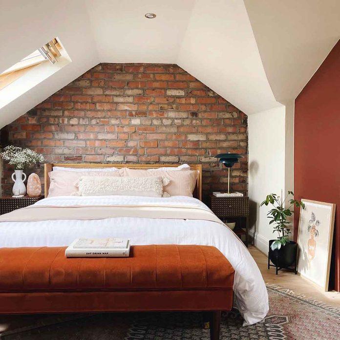 attic bedroom brick wall