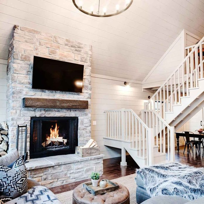 cabin bright white fireplace