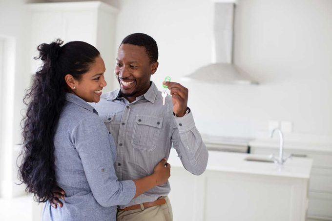 Couple Holding Keys Gettyimages 565887175