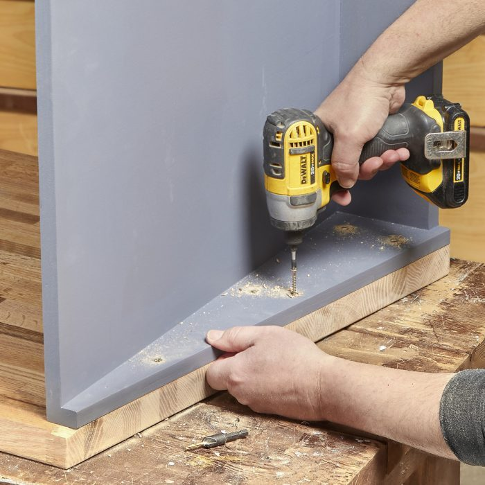 Fasten the cabinet to the work surface