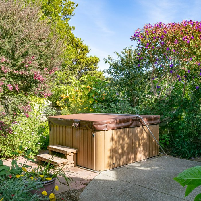 hot tub with cover closed in backyard