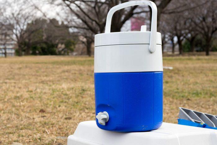 Blue water jug at camp site