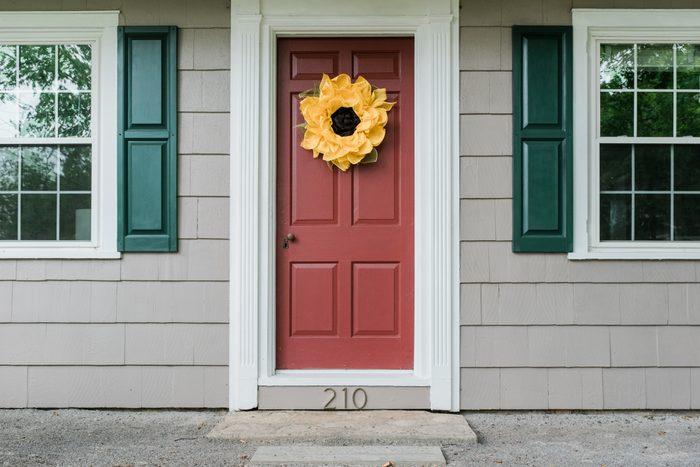 front door of house showing outdoor trim around windows and door