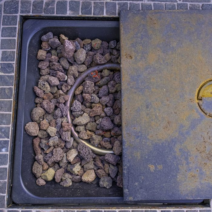 Table Fire Pit with rocks on outside deck patio at home