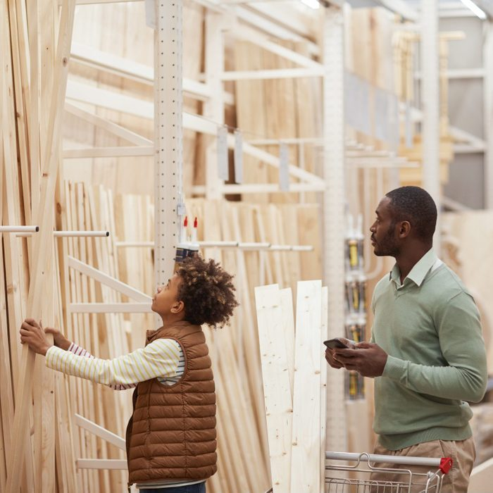 Father and Son Buying lumber in store