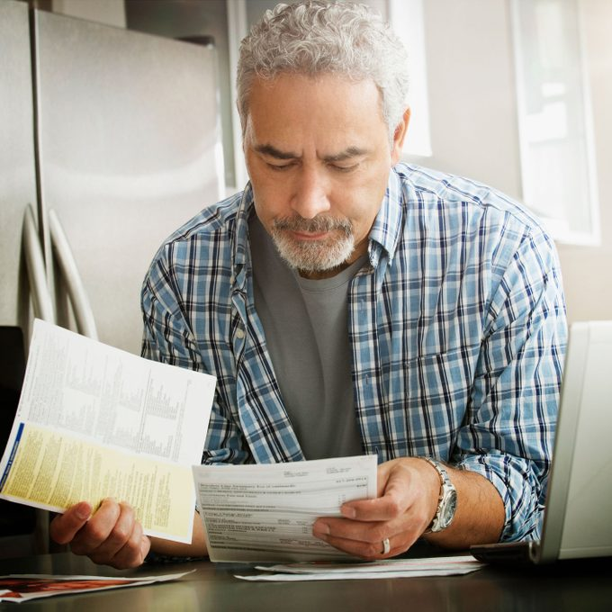 man looking at air conditioning bill