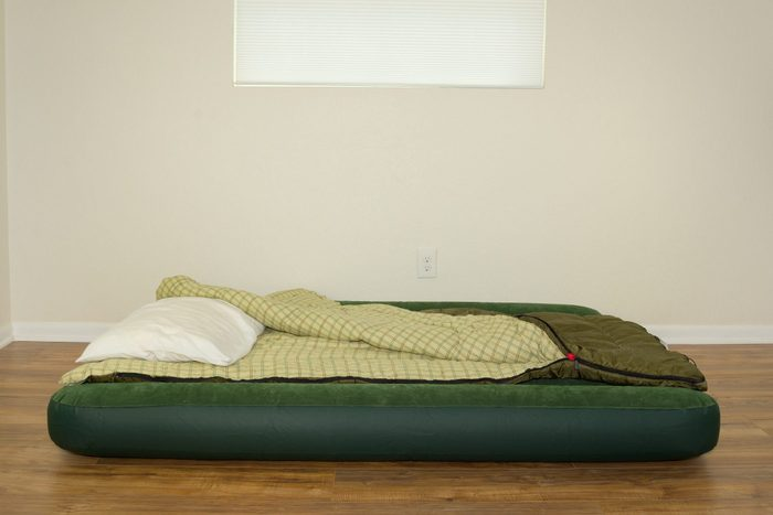 Blow up air mattress bed with sleeping bag and pillow