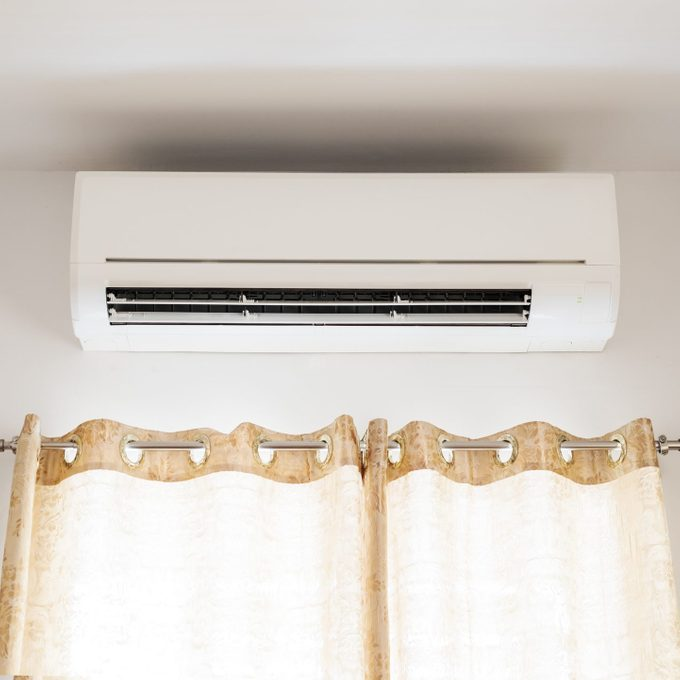 wall mounted Air conditioning above window in a house