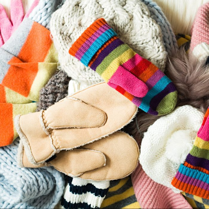 a mixed array of winter hats and mittens