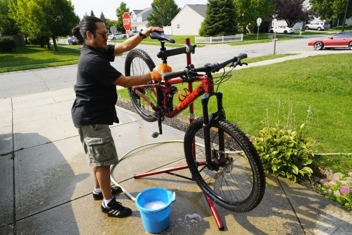 man cleaning his bike