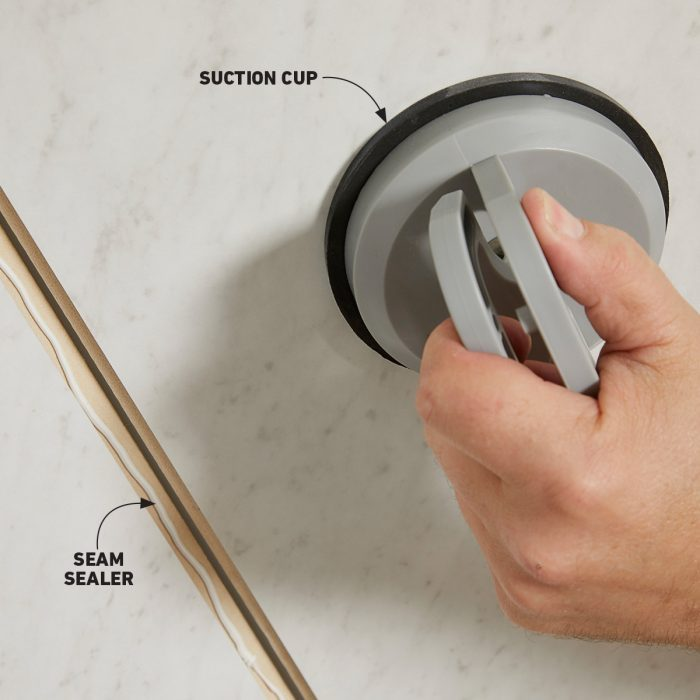 Using a tile setting suction cup to set panels