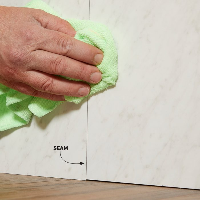 Wiping off excess seam sealer with denatured alcohol