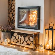 wood burning in fireplace to heat a home in the winter
