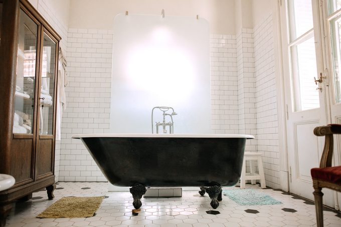 free standing clawfoot tub in large bathroom