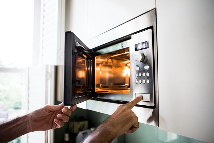 close up of using a microwave at home