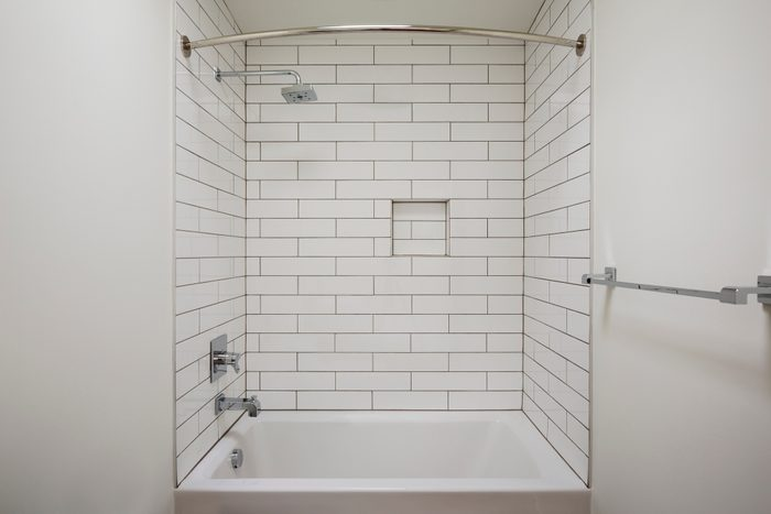 alcove or recessed bathtub in bathroom