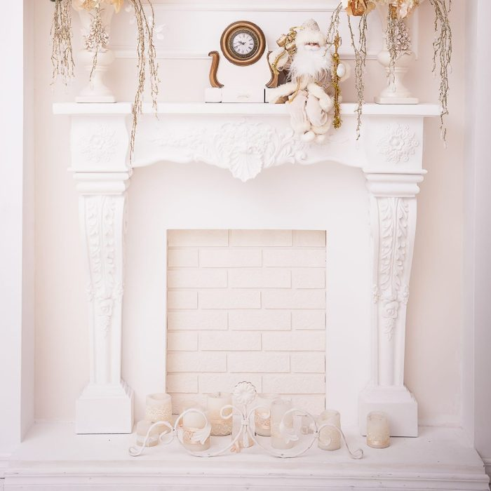white fireplace in classical arch .