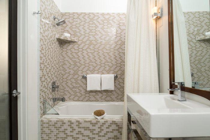 Modern Tiled Bathroom with bath tub and shower combo