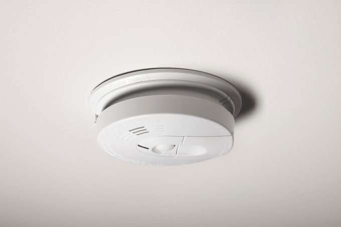 Smoke Detector on the ceiling inside a home