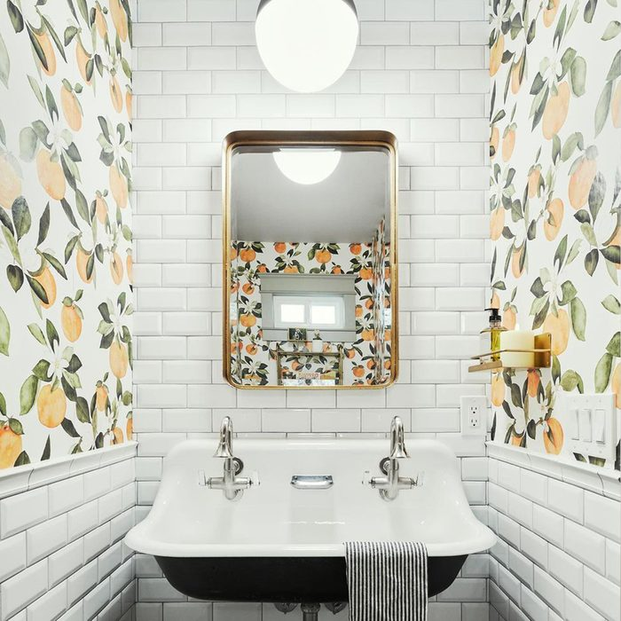 Subway Tile with Wallpaper in bathroom
